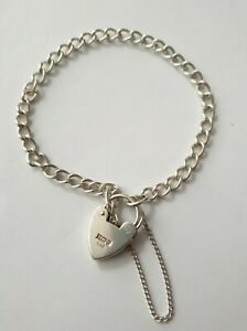 Vintage sterling silver charm bracelet with heart padlock and safety chain