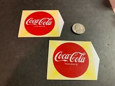 2 Vintage Coca Cola Celluloid or Plastic Opaque Drink Machine Button Signs