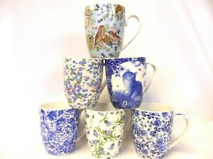 set of 6 china mugs in assorted blue floral designs.