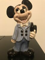 Disney Traditions- Mickey Mouse - Mickey Mouse with his hat in his hand.