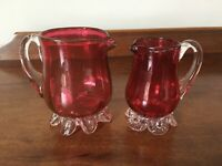 2 small Cranberry glass jugs with clear handles and bases