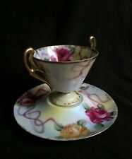 Antique hand painted tea cup & saucer