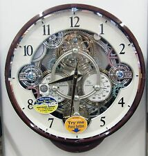 "NEW RHYTHM MUSICAL MAGIC MOTION WALL CLOCK -""WIDGET"" 4MH886WU23- MOVING. GEARS"