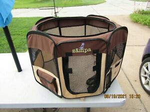 Nice used Zampa 8 sided pet kennel/playpen.  Folds up for easy storage.