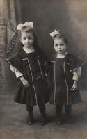 VINTAGE POSTCARD TWO SISTER SIBLINGS RPPC ON KRUXO REAL PHOTO c. 1910