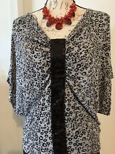 julies closet,size M,animal print,sequins in from,short Sleeve.