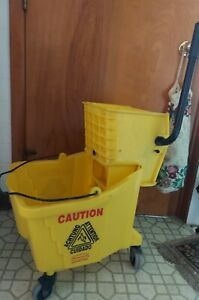 7570 Rubbermaid Press Mop Bucket w/ Wringer - used - yellow 35qts