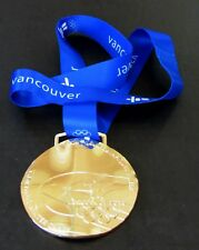 2010 VANCOUVER WINTER OLYMPICS GOLD MEDAL WITH SILK RIBBON & STORAGE POUCH