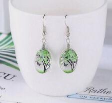 DRIED FLOWER TREE OF LIFE BUTTERFLY GLASS CABOCHON DANGLE EARRINGS. GREEN