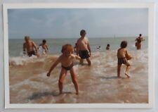 1970s/ 1976 Colour Photograph. Hottest Summer in Britain. Men & Boys at Beach