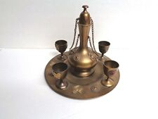 ANTIQUE BRASS DECANTER with 4 GOBLETS