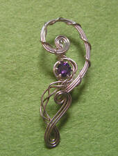 Hand crafted sterling silver pendant with purple cubic zirconia