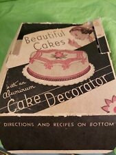 Vintage cake decorating tips in box....never used