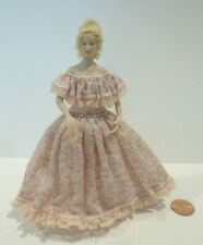 LOVELY MINIATURE PORCELAIN LADY DOLL DRESSED IN A PINK DRESS