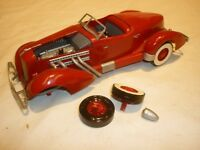 A Built plastic kit of a 1935 Auburn speedster,  damaged with parts missing