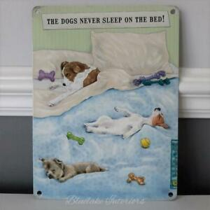 The Dogs Never Sleep On The Bed!  Metal Wall Sign