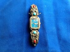 sterling, turquoise and cora watch band sides.