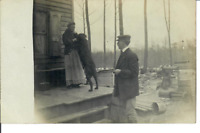 Woman with Dog on Porch Man Looking at Them RPPC Unposted Postcard