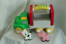 LITTLE TIKES HAND HELD FARM TRUCK  WITH SOUNDS,MUSIC, COW AND A PIG