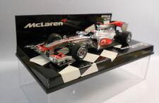 Voiture de sport de courses miniatures sur Jenson Button