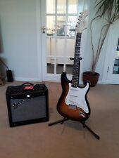 Fender Mustang I V.2 amp and Fender Squire Stratocaster guitar