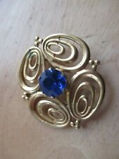 Vintage brooch with blue stone.