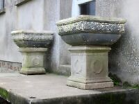 Pair of 20th Century Composite Stone Planters on Laurel Wreath Plinths