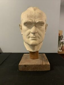 15 inch clay sculpture of a man's head
