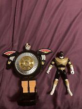 Power Rangers Gold Ranger action figure and Warrior wheel zord