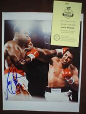 Larry Holmes signed fight photo with Ali