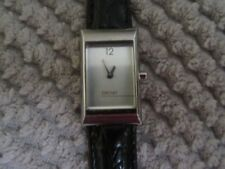 Authentic DKNY stainless steel and genuine New battery- new Black Leather band