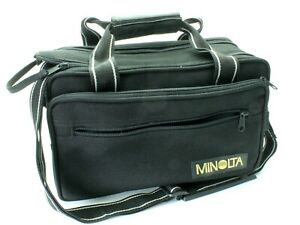 Minolta Camera Bag. Inc Shoulder Strap. Good Capacity. Padded. Good Condition.