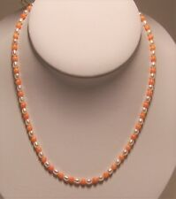 New hand strung  fresh water cultured pearl & pink coral bead necklace.