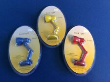 Mini book light with adjustable neck clip, portable, in yellow, blue, or red, 4""