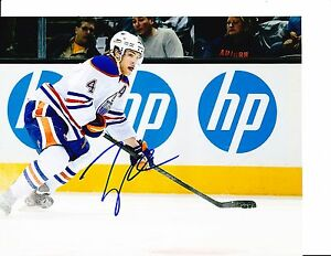 EDMONTON OILERS TAYLOR HALL SIGNED PASSING 8X10