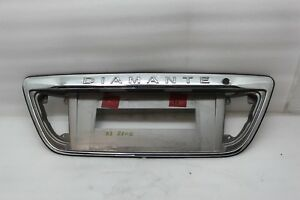 97-03 Mitsubishi Diamante Rear Trunk License Plate Holder Molding Emblem