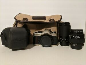 Nikon FM10 35mm SLR Camera w/ 2 Lenses And Bag