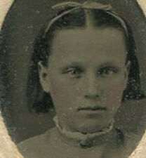 YOUNG GIRL WITH HAIR BOB AND RIBBON. TINTED TINTYPE, PERIOD PAPER MAT.