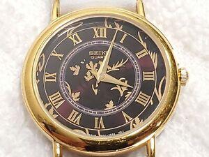 Vintage Seiko Quartz Watch Black Floral Dial Gold Tone Roman Numerals Women's