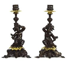 Pair of French Antique Rococo Candlesticks with Putto Candle Holders