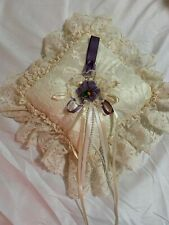 Wedding Ring Bearer Pillow.Beige with plum color accents.Has pearls & satin.
