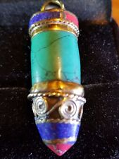 Nepalese bullet shaped resin pendant turquoise brass 40mm