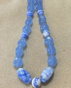Vintage Glass Beads West German Beads and Opalescent Blue Beads.