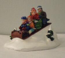 Christmas Figurines sledding family