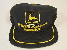 VINTAGE Mens Cap STRICKER IMPLEMENT black JOHN DEERE Woodward, Oklahoma [Y39B4]