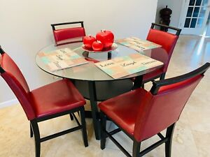 1 dining table with 4 chair red color.