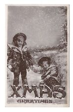 Vintage RP postcard Xmas Greetings. 2 young boys playing in the snow. Davidson