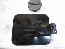 2003 Kia Spectra LS Fuel door with gas cap Color is black