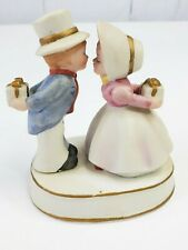 Sweet Colonial Boy and Girl Best Dress Kissing and Hiding Gifts From Each Other