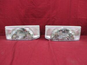 NOS OEM Ford Escort Head light Headlamp Lens Assembly 1991 - 96 PAIR